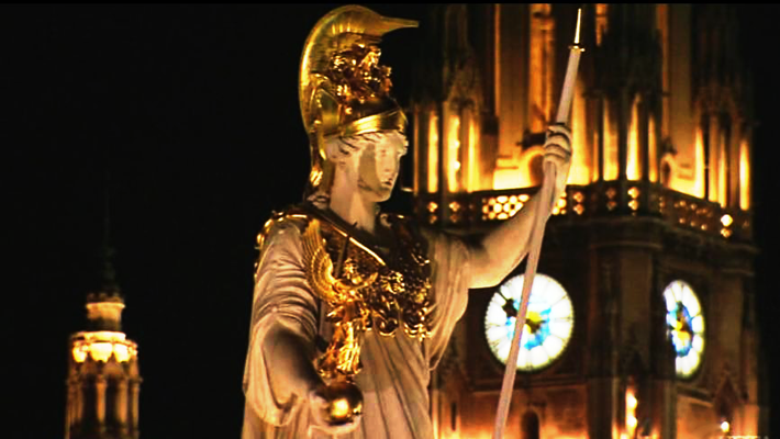 Golden roman statue in Berlin at night