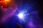 Lights shining through circus wires