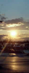 Sunset reflecting on icy parking lot